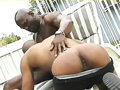 Muscled black hunk gives his ebony suitor a deep anal pounding outside